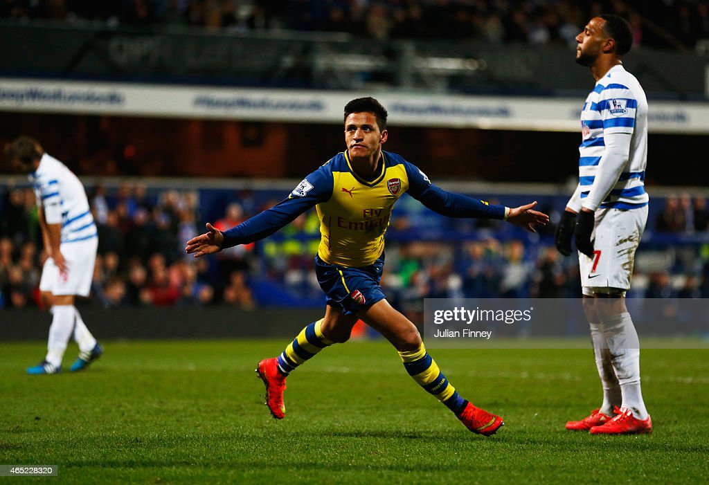 Despair for QPR players as Alexis Sanchez of Arsenal scores their second goal during the Barclays Premier League match between Queens Park Rangers and Arsenal at Loftus Road on March 4, 2015 in London, England.