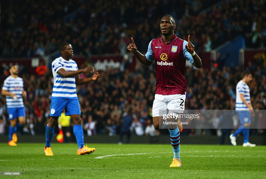 Despair for QPR players as Christian Benteke of Aston Villa (20) celebrates as he scores their second goal during the Barclays Premier League match between Aston Villa and Queens Park Rangers at Villa Park on April 7, 2015 in Birmingham, England.