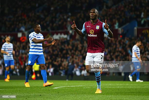 Despair for QPR players as Christian Benteke of Aston Villa celebrates as he scores their second goal during the Barclays Premier League match...