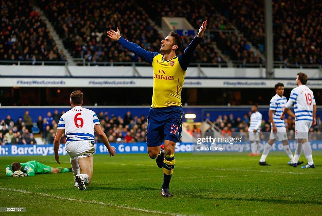 Despair for QPR players as Olivier Giroud of Arsenal celebrates scoring their first goal during the Barclays Premier League match between Queens Park Rangers and Arsenal at Loftus Road on March 4, 2015 in London, England.