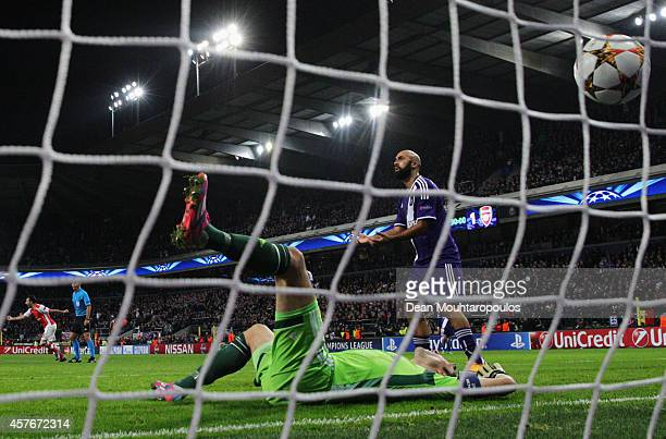 Despair for Silvio Proto and Anthony Vanden Borre of Anderlecht as Lukas Podolski of Arsenal scores his team's second goal during the UEFA Champions...