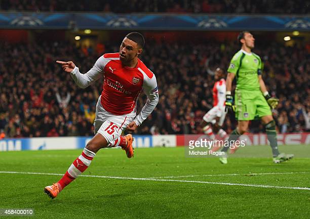 Despair for Silvio Proto of Anderlecht as Alex OxladeChamberlain of Arsenal celebrates as he scores their third goal during the UEFA Champions League...
