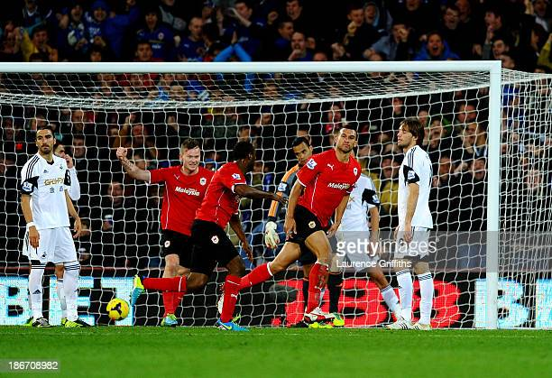 Despair for Swansea City as Steven Caulker of Cardiff City celebrates scoring their first goal during the Barclays Premier League match between...