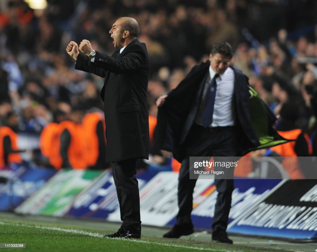 Despair for Walter Mazzarri coach of Napoli (R) as Roberto Di Matteo caretaker manager of Chelsea celebrates during the UEFA Champions League Round of 16 second leg match between Chelsea FC and SSC Napoli at Stamford Bridge on March 14, 2012 in London, England.
