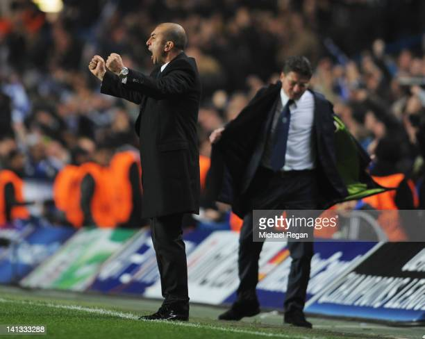 Despair for Walter Mazzarri coach of Napoli as Roberto Di Matteo caretaker manager of Chelsea celebrates during the UEFA Champions League Round of 16...