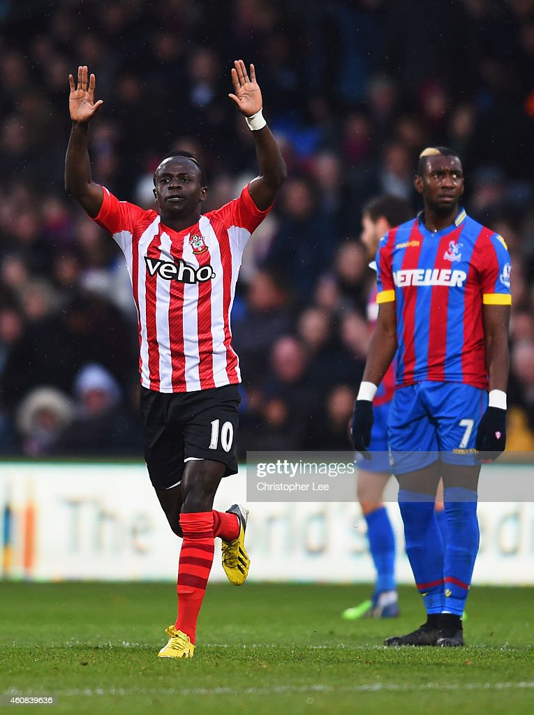 Despair for Yannick Bolasie of Crystal Palace (7) as Sadio Mane of Southampton (10) celebrates scoring their first goal during the Barclays Premier League match between Crystal Palace and Southampton at Selhurst Park on December 26, 2014 in London, England.