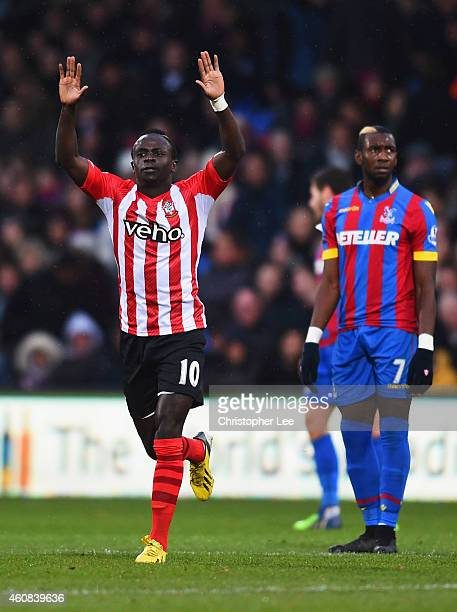 Despair for Yannick Bolasie of Crystal Palace as Sadio Mane of Southampton celebrates scoring their first goal during the Barclays Premier League...