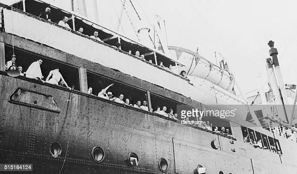 Despairing GermanJewish refugees their hopes of sanctuary in Havana dashed when Cuban immigration officials refused them entry are shown waving...