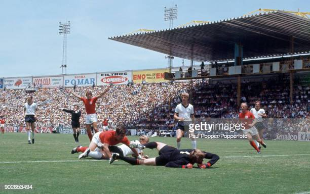 A desparate challenge from West Germany's Berti Vogts can't prevent Alan Mullery of England scoring the first goal past the German goalkeeper Sepp...