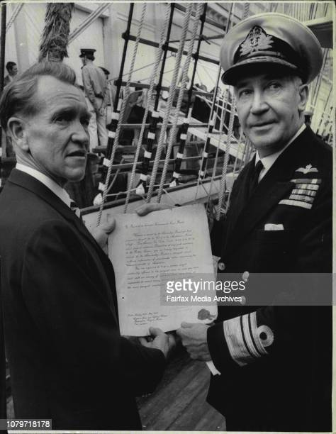 Despatches Exchanged on Regina MarisHere Vice Admiral Sir V A T Smith hands over document acknowledging receipt of despatch from the Admiralty and...