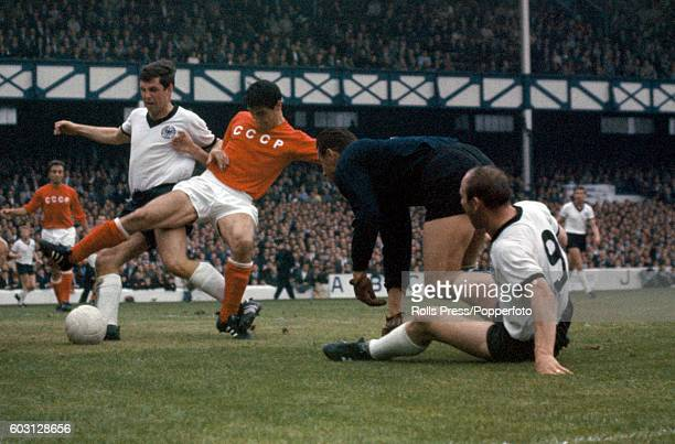 Desperate defending by the Soviet Union to thwart Uwe Seeler and Lothar Emmerich of West Germany during the World Cup semifinal between West Germany...