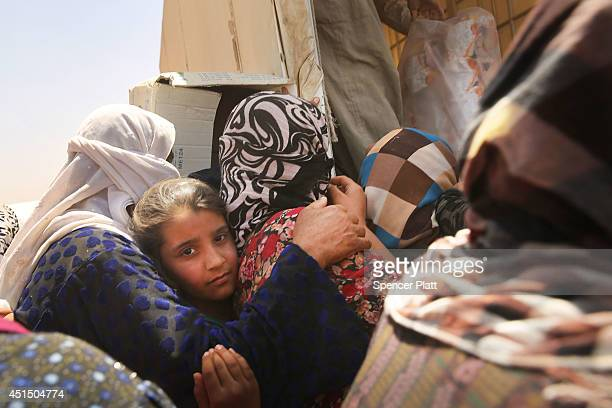 Desperate Iraqi's at the Khazair displacement camp for those caughtup in the fighting in and around the city of Mosul wait for food and other items...