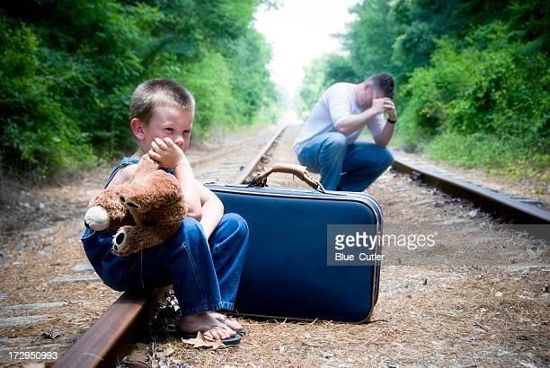 Desperate man and child on train tracks