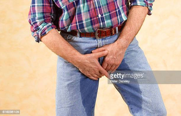desperate man wetting himself - trousers stock pictures, royalty-free photos & images