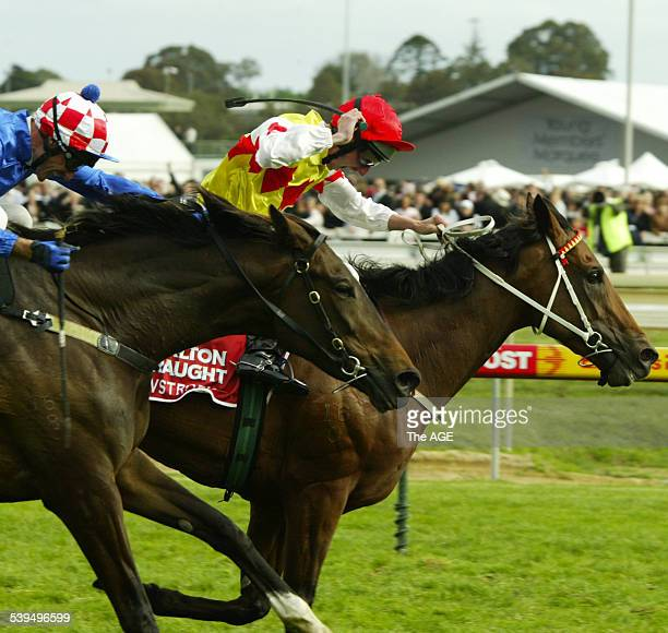 Nash Rawiller riding Elvstroem right and Glen Boss throw everything at their mounts in a gripping finish to the Caulfield Cup 16 October 2004 THE AGE...