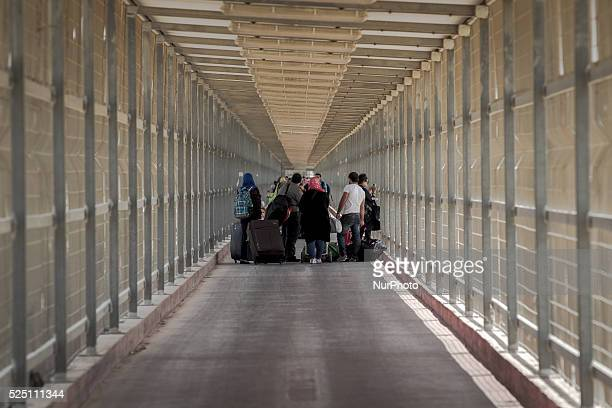 Desperate Palestinian refugees waiting for hours in front of the Israeli border crossing at Erez to escape the war in Gaza after the ground invasion...