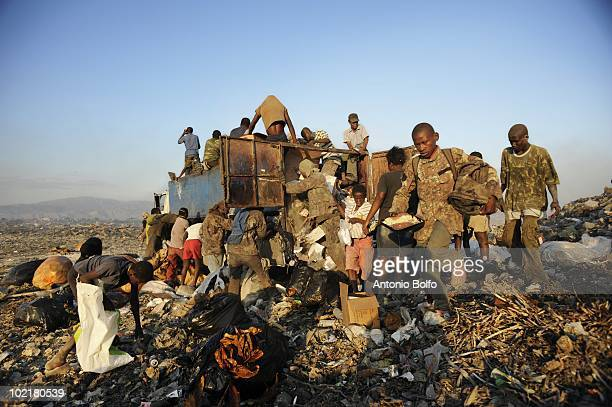 Desperate people ravage a garbage truck at the Cite Soleil dumping grounds in hopes of finding food March 7 2010 in Cite Soleil Port au Prince Haiti