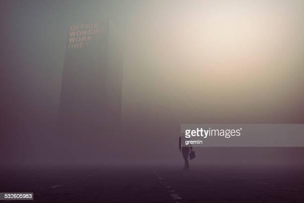 Desperate, tired businessman walking towards office building