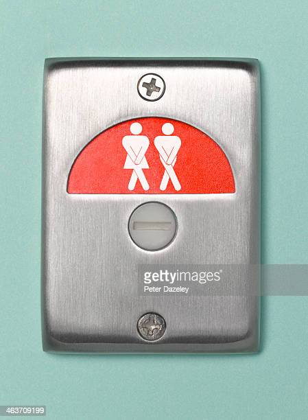 desperate toilet door sign engaged - public toilet stock pictures, royalty-free photos & images