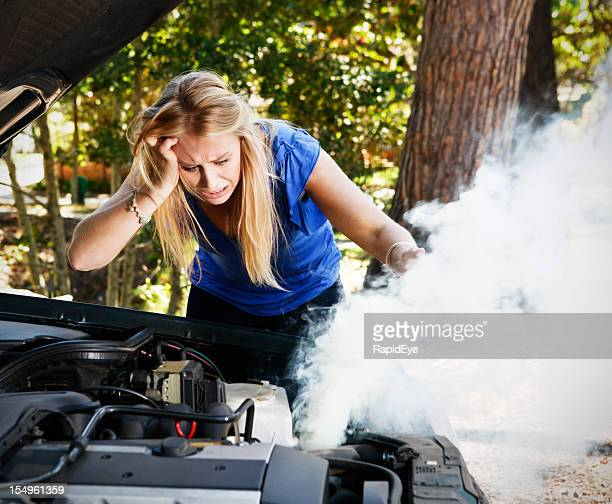 Desperate young woman stranded with broken down car