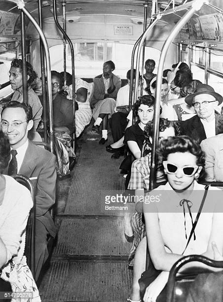 Despite a court ruling on desegregating buses, white and blacks continue to be divided by their own choice.