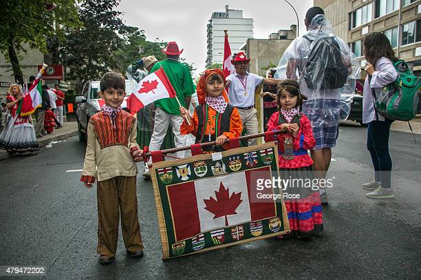 Despite a heavy rain ethnic organizations parade down SainteCatherine Street in celebration of Canada Day on July 1 2015 in Montreal Quebec Canada...