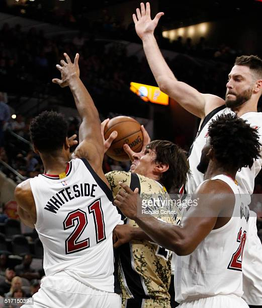 Despite being swarmed by Miami Heat players Boban Marjanovic of the San Antonio Spurs was able to score at ATT Center on March 19 2016 in San Antonio...