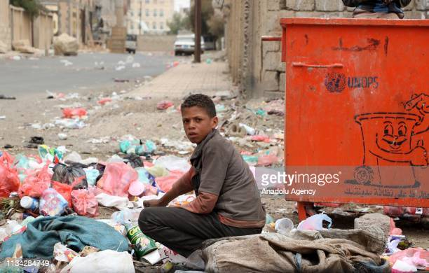 Despite cholera outbreak Yemeni kids collect garbages form piles of rubbish for recycling in Sana'a Yemen on April 1 2019 According to World Health...