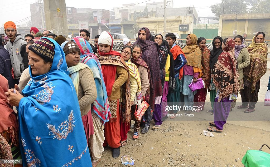 Despite cold weather people queuing outside the State Bank of India branch to get cash at Batala Road on December 29 2016 in Amritsar India