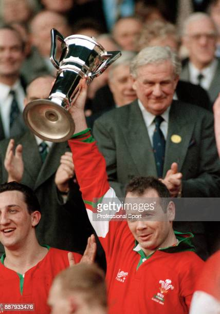 Despite losing to England 159 Wales captain Ieuan Evans lifts the Five Nations Rugby Championship trophy with Dudley Wood behind at Twickenham in...