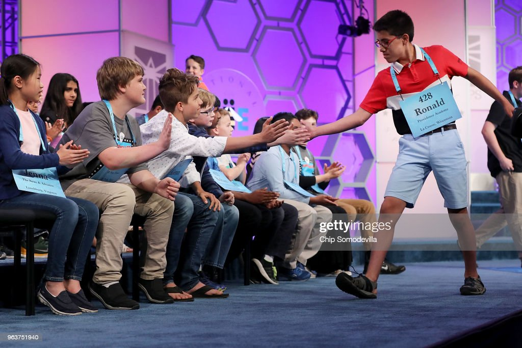 Despite misspelling his word, Ronald Walters of Onalaska, Wisconsin, is high-fived by his fellow competitors during the third round of the 91st Scripps National Spelling Bee at the Gaylord National Resort and Convention Center May 30, 2018 in National Harbor, Maryland. 516 spellers from across the country and around the world competed in the bee.