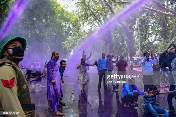 LAL CHOWK SRINAGAR JAMMU KASHMIR INDIA Despite of coloured water canon used by JK Police Kashmiri Government teachers shouts anti Government slogans...