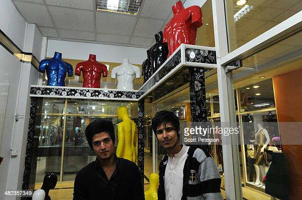 Despite preelection violence Afghan students Mohammad Fardeen and Romal Shafaq prepare to open their new men's fashion shop 'Lifestyle' with brightly...