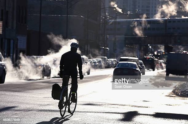 Despite temperatures hovering around 10 degrees a bike rider makes his morning commute January 28 2014 in Chicago Illinois The city has had 18 days...