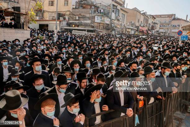 Despite the coronavirus pandemic, thousands of Ultra-orthodox Jewish men attend the funeral of Rabbi Aharon David Hadash, the spiritual leader of the...