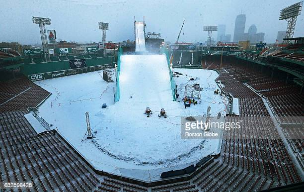 Despite the fact that natural snow was falling this afternoon snowmaking guns are going full blast on the manmade hill at Fenway Park on Feb 8 2016...