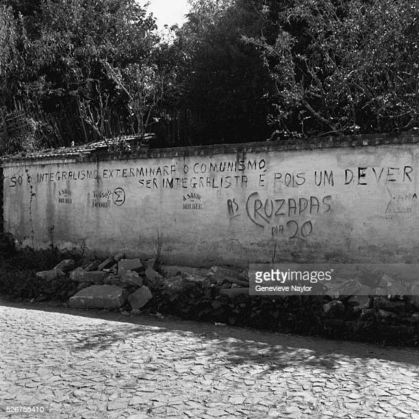 """Despite the government's ban on political organizations, the fascist Integrals spraypainted this slogan on a stone wall: """"INTEGRALISM WILL..."""