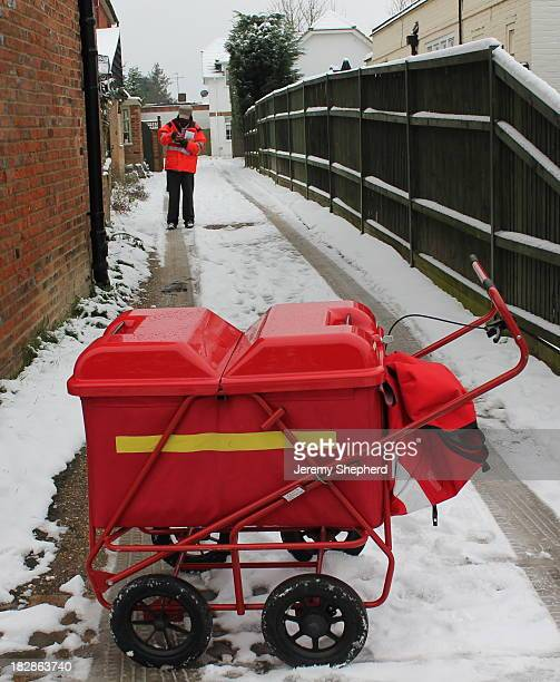 CONTENT] Despite the heavy snow yesterday the Beaconsfield postie is still on his rounds with his trusty trolley