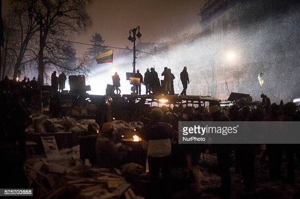 Despite the resignation of prime minister Mikola Az����rov ukranian protester spend the night at barricades In the picture some protesters defend the...
