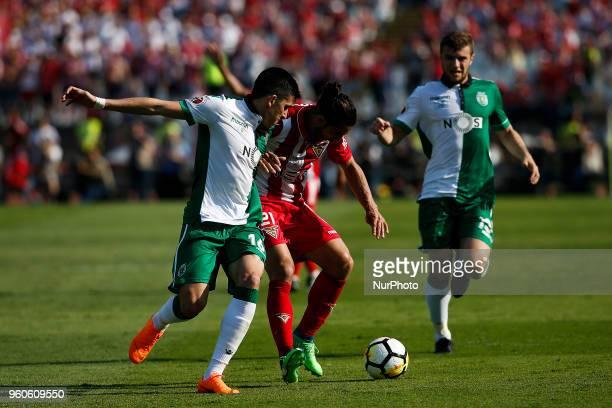 Desportivo Aves's defender Nelson Lenho vies for the ball with Sporting's midfielder Rodrigo Battaglia and Sporting's defender Stefan Ristovski...