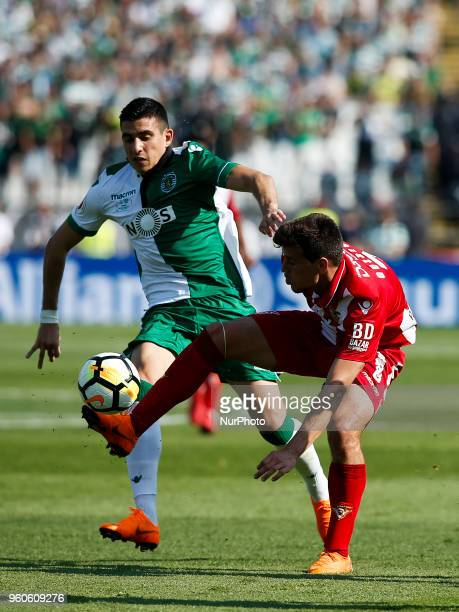 Desportivo Aves's forward Alexandre Guedes vies vies for the ball with Sporting's midfielder Rodrigo Battaglia during the Portugal Cup Final football...