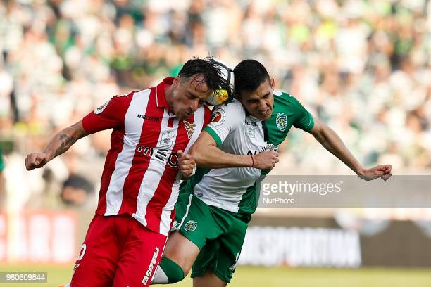 Desportivo Aves's midfielder Vitor Gomes heads for the ball with Sporting's midfielder Rodrigo Battaglia during the Portugal Cup Final football match...