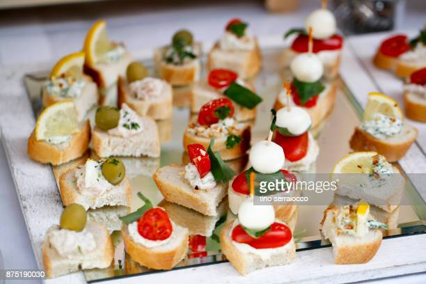 dessert buffet in a traditional italian wedding - buffet stock pictures, royalty-free photos & images