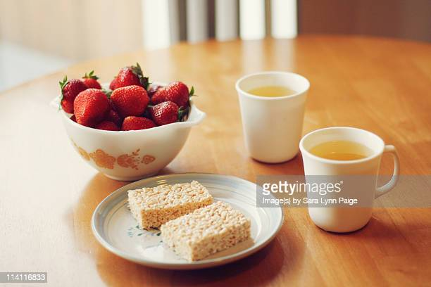 dessert for two  tea, strawberries, crispy treats - crunchy stock pictures, royalty-free photos & images