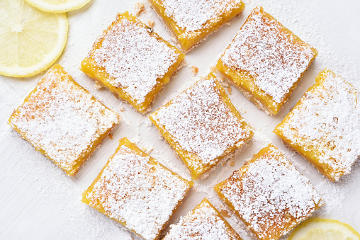 Dessert lemon bars over baking paper 544967548
