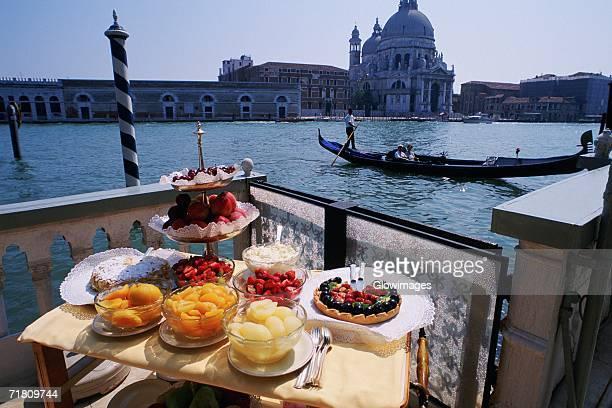Dessert on a table near a canal, Grand Canal, Venice, Veneto, Italy