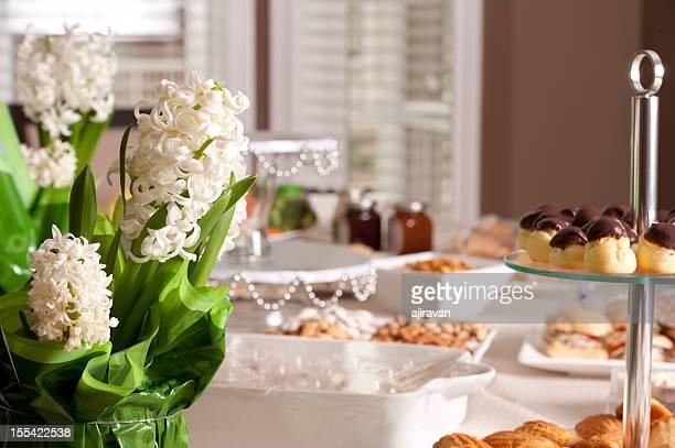 Dessert table with a flower arrangement