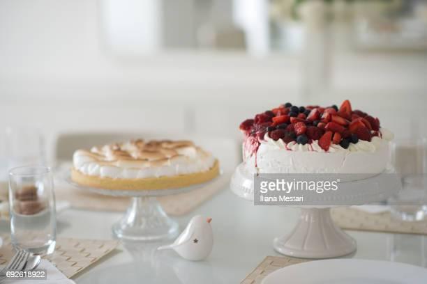 Dessert table with home-made Pavlova, Macarons and Lemon pie