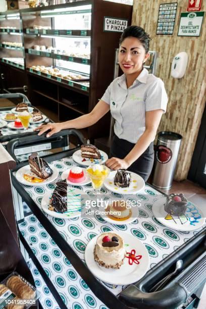 A dessert tray display sale at La Casa de los Abuelos restaurant