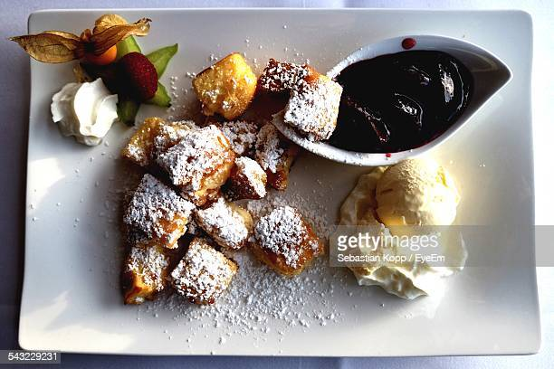 Dessert With Ice-Cream And Jam On Plate